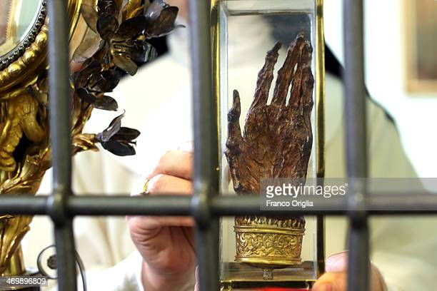 Sister Maria Domenica holds the hand of Saint Catherine of Siena at the cloistered convent of St Mary of the Rosary on February 6 2014 in Vatican...