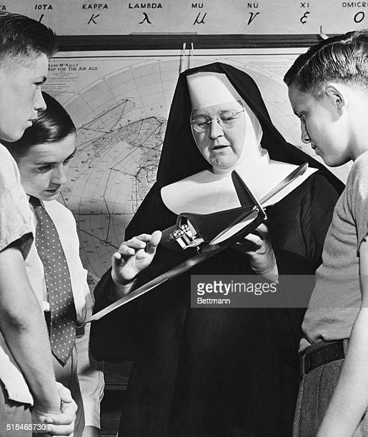 Sister Mary Aquinas who gives a civil aeronautics authority course for instructors at Catholic University in Washington still finds time to talk...