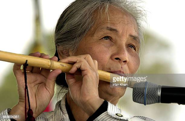 Sister Mary Dao plays a bamboo flute at Multi–Cultural Festival 2002 which was held in Westminster The exhibitions of art live entertainment a...