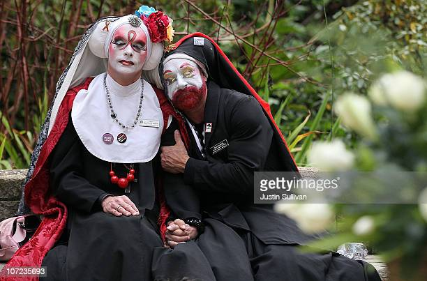 Sister Mary Timothy Simplicity and Sister Jezabelle of the of Enraptured Sling of The Sisters of Perpetual Indulgence embrace as the names of AIDS...