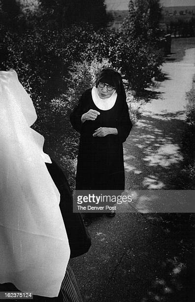 JUL 31 1972 AUG 3 1972 Sister Mechtildis Stops to Speak With Another Nun On Convent Pathway