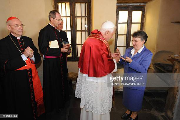 Sister Michele Coeurderoy shows on September 13, 2008 Bernadette Soubirous' rosary to Pope Benedict XVI as he visits the Cachot, an abandoned prison...