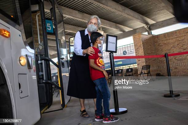 Sister Norma Pimentel, Executive Director of Catholic Charities of the Rio Grande Valley escorts a young asylum seeker upon his entry into the United...