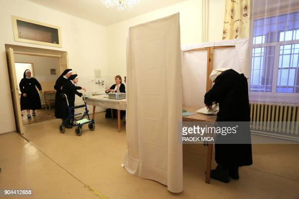 A sister of Boromei stands in the voting booth on January 13 2018 at the monastery in Albrechtice Northern Moravia Czech Republic on boarder with...