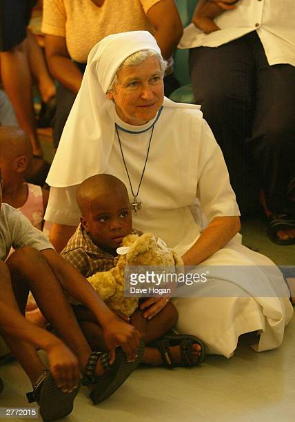 Sister of Nazareth with a child at Nazareth House for orphaned and abused children with HIV which singer Anastacia visited the day after the 46664...