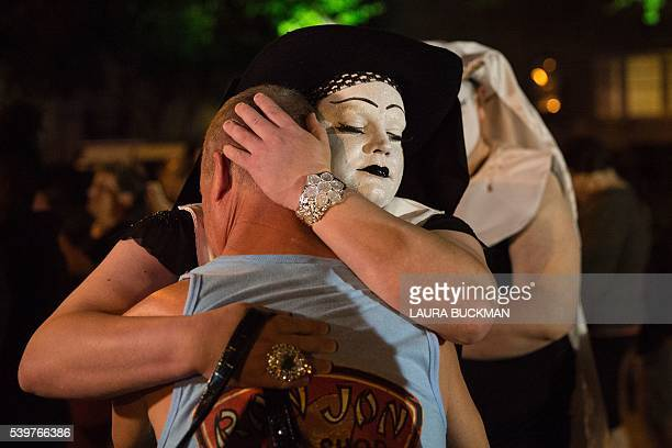 Sister of Perpertual hugs a mourner during a vigil in Dallas Texas on June 12 for victims of the attack at Orlando's Pulse Nightclub in Orlando...