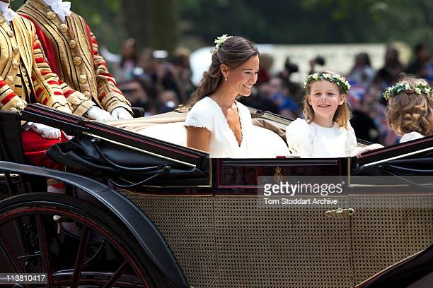 Sister of the bride and Maid of Honour Pippa Middleton makes her journey by carriage in the procession to Buckingham Palace following the Royal...