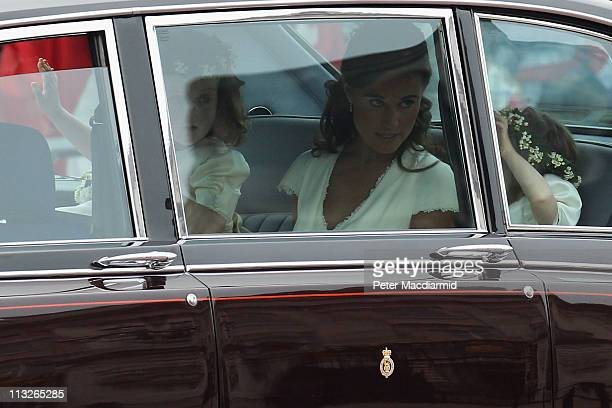 Sister of the bride and Maid of Honour Pippa Middleton travels past Buckingham Palace with Grace Van Cutsem and Eliza Lopes as they make their way to...