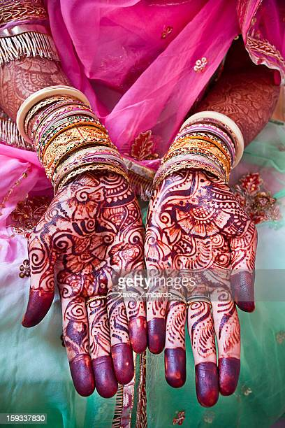 A sister of the bridegroom displaying the 'mehendi' put on her hands on February 16 2011 at Jhala House in Pali Marwar Rajasthan India