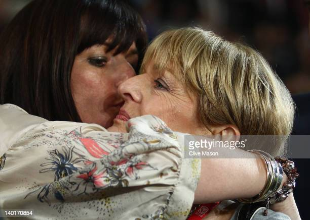Sister of the late Gary Speed Lesley Haylock is seen embracing mother of the late Gary Speed Carol Speed during the Gary Speed Memorial International...