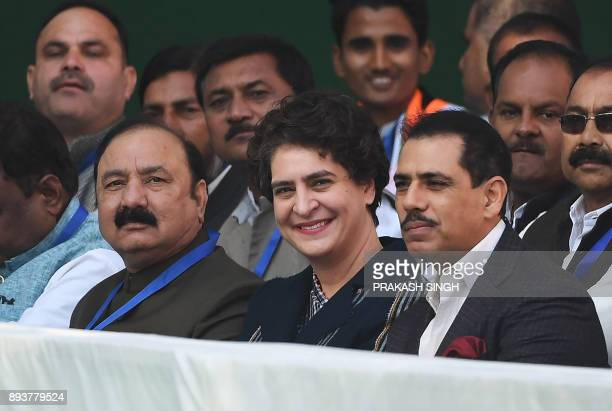 Sister of the newlyelected party President Rahul Gandhi Priyanka Gandhi Vadra and her hushband Roberto Vadra attend a ceremony at the party...
