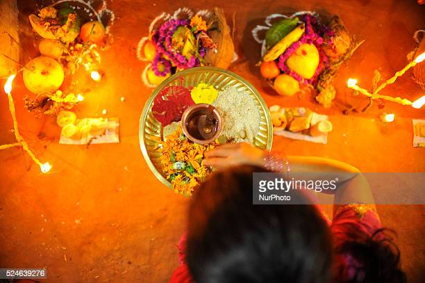A Sister offering puja towards mandap in front of Bhai Tika procession on the fifth and last day of Tihar is called Bhai Tika or Kija Puja at Nagaun...
