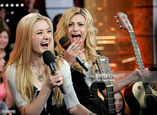 Sister singing act AJ and Aly appear on MTV's Total Request Live at MTV's Time Square Studios March 13, 2006 in New York City.
