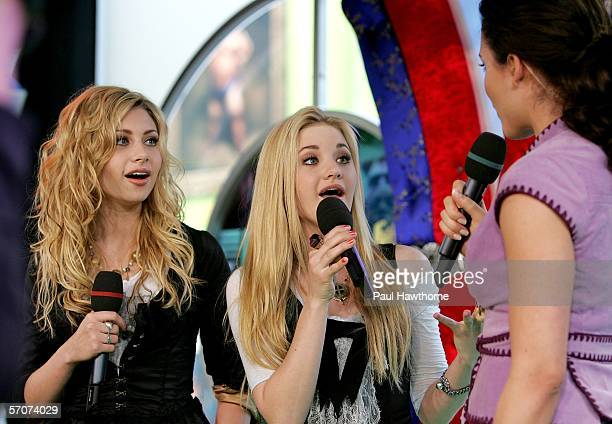 Sister singing act Aly and AJ appear on MTV's Total Request Live at MTV's Time Square Studios March 13, 2006 in New York City.