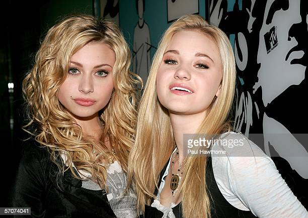 Sister singing act Aly and AJ pose for photos after making an appearance on MTV's Total Request Live at MTV's Time Square Studios March 13, 2006 in...