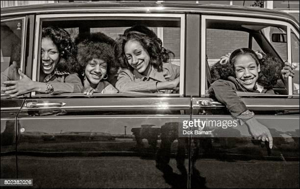 Sister Sledge group portrait in a car Heathrow Airport April 1975