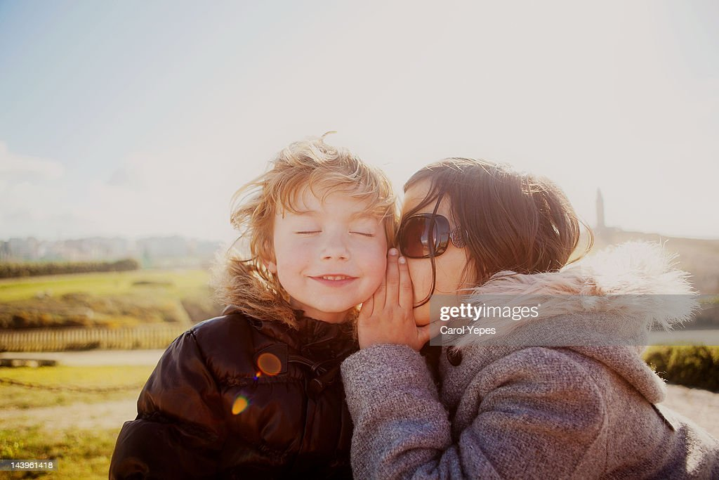 Sister tell brother secrets : Stock Photo
