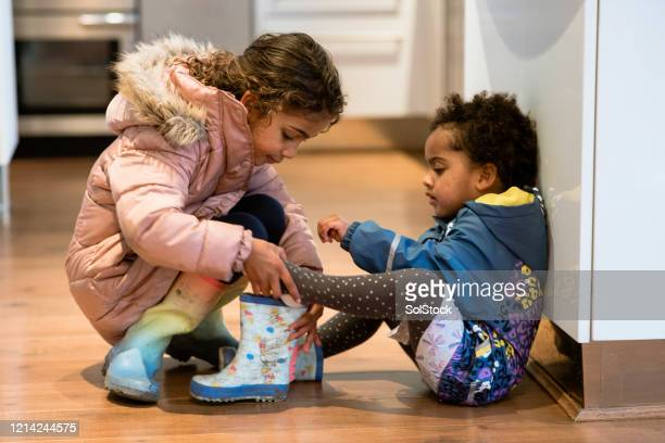 sisterly love - only girls stock pictures, royalty-free photos & images