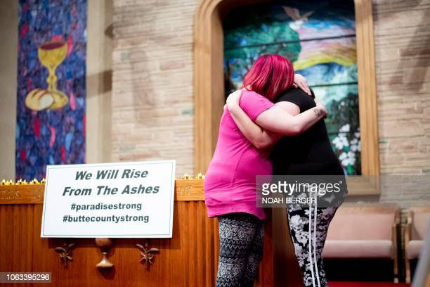 Sisters Alli Benefield left and Kassy Parish embrace during a vigil for the lives and community lost to the Camp Fire on Sunday November 18 at the...
