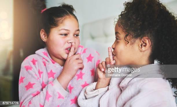 sisters always keep secrets - data privacy imagens e fotografias de stock