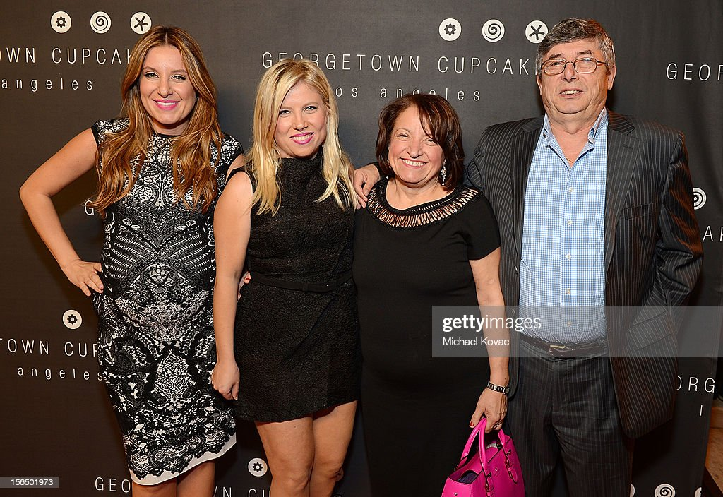Sisters and co-owners Katherine Kallinis Berman (L) and Sophie Kallinis LaMontagne (2nd L) and their parents attend the Los Angeles Grand Opening of Georgetown Cupcake Los Angeles on November 15, 2012 in Los Angeles, California.