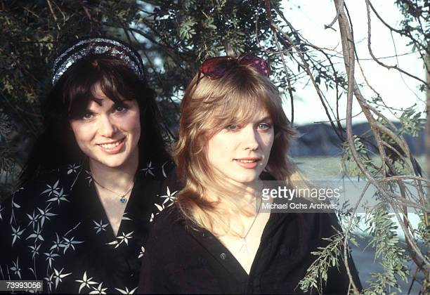"""Sisters and musicians Ann Wilson and Nancy Wilson of the rock band """"Heart"""" pose for a portrait session in September 1976 in Los Angeles, California."""