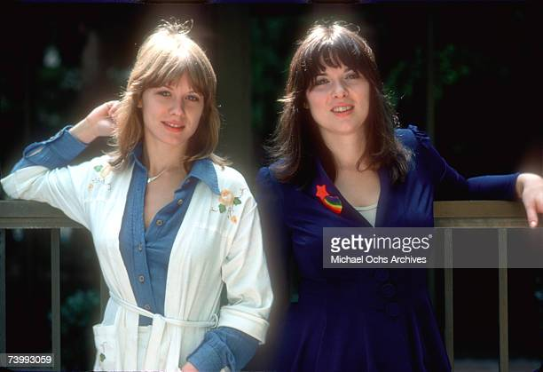 Sisters and musicians Ann Wilson and Nancy Wilson of the rock band 'Heart' pose for a portrait session in September 1976 in Los Angeles California