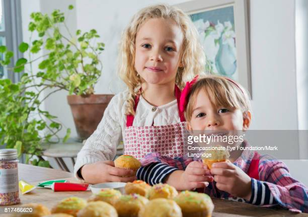 sisters baking in kitchen - children only stock pictures, royalty-free photos & images