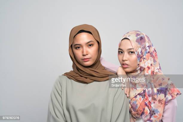 sisters by faith - malaysia beautiful girl stock photos and pictures
