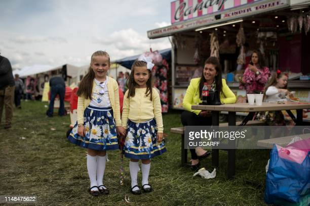 Sisters Catherine, aged 5, and Clara, aged 7, attend the second day of the annual Appleby Horse Fair, in the town of Appleby-in-Westmorland, north...