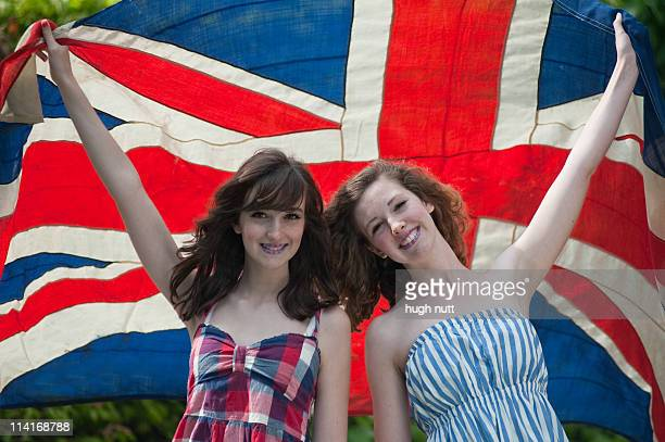 sisters celebrating the royal marriage - lymington stock photos and pictures