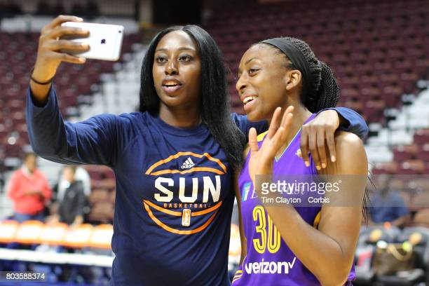 Sisters Chiney Ogwumike of the Connecticut Sun and Nneka Ogwumike of the Los Angeles Sparks film an iPhone video after the Los Angeles Sparks Vs...