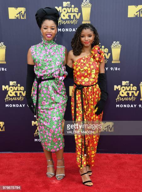 Sisters Chloe and Halle Bailey of US RB duo Chloe X Halle attend the 2018 MTV Movie TV awards at the Barker Hangar in Santa Monica on June 16 2018...