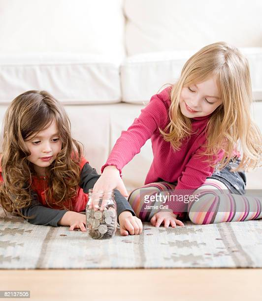 Sisters counting coins