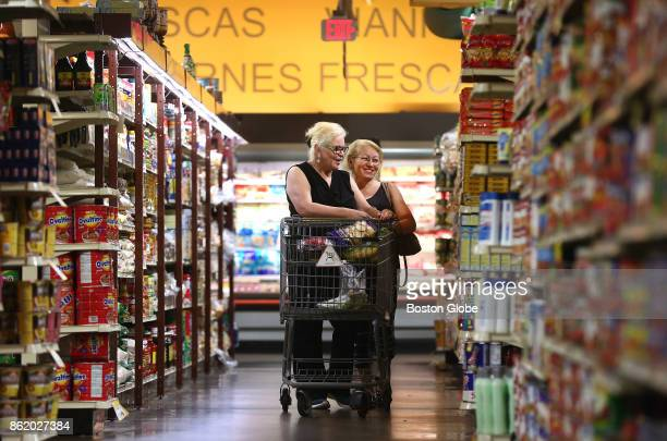 Sisters Cruz Sanchez left of Mattapan and Frances Rosado of Dorchester shop at Tropical Foods in the Roxbury neighborhood of Boston on Aug 22 2017...