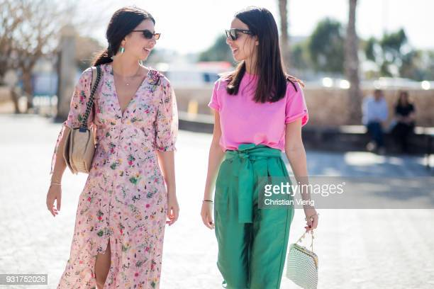 Sisters Dana Cohen wearing dress with floral print sneakers and Yarden Cohen wearing pink shirt green pants bag Converse shoes is seen during Tel...