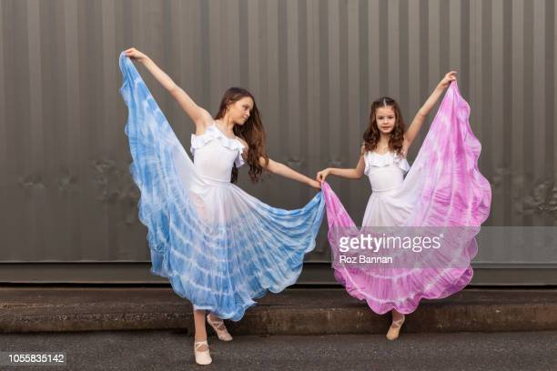 sisters dancing in the street - model roz stock pictures, royalty-free photos & images