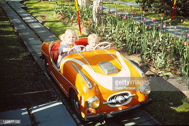 Sisters driving track car in 1960s