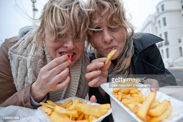 Sisters eating chips