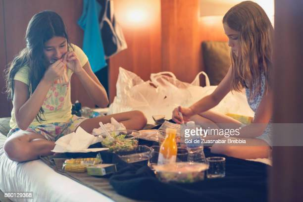 Sisters eating together in the room