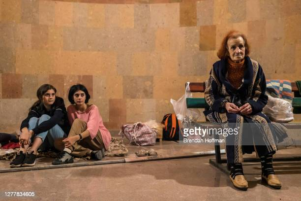 Sisters Galina and Elina Balasanyan and their neighbor Lilia Babayan in the basement of a church where they have been sheltering from fighting since...