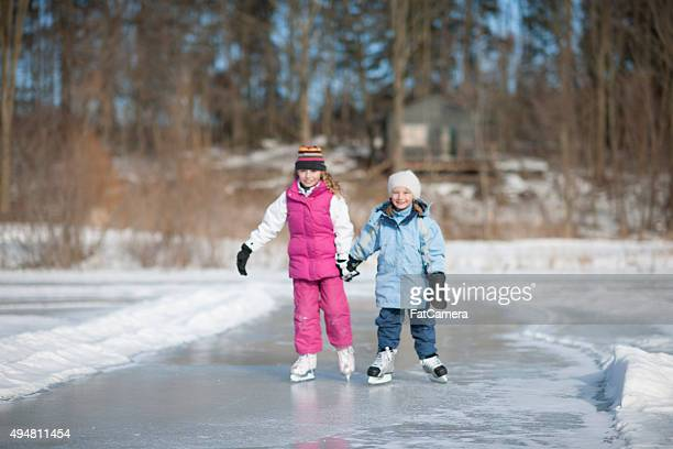 Sisters Happily Ice Skating Together