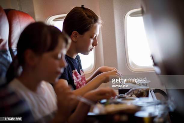 Sisters having airplane food