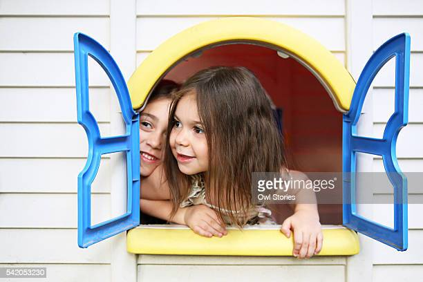 Sisters having fun in a play house