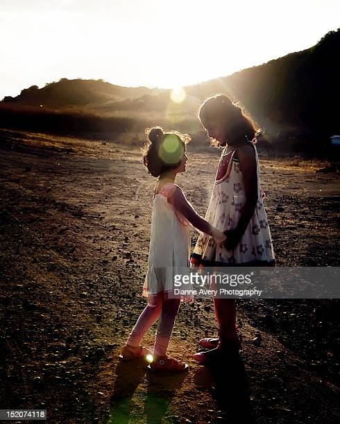 sisters holding hands - salwar kameez stock pictures, royalty-free photos & images