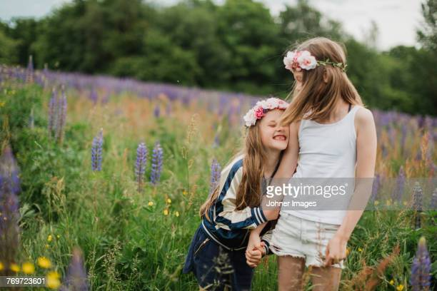 sisters hugging - midsommar stock pictures, royalty-free photos & images