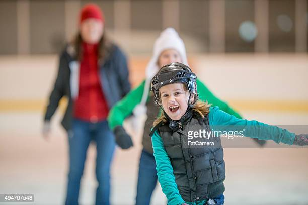 Sisters Ice Skating Together at the Rink