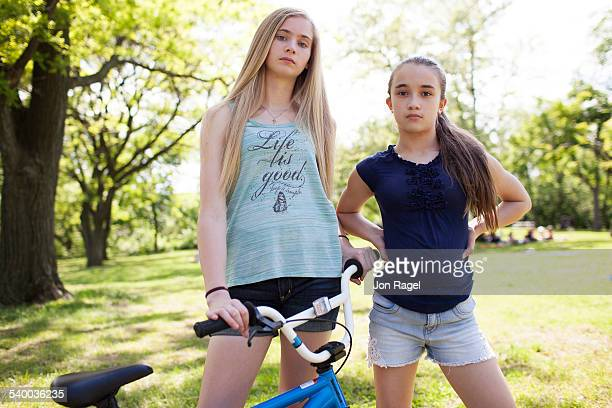 Sisters in a park with bmx bike