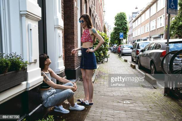 sisters in amsterdam city street spending a day off together - residential district stock pictures, royalty-free photos & images