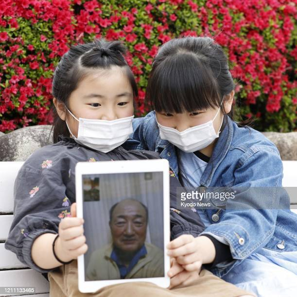 Sisters in Ashiya Hyogo Prefecture have live video chat with their grandfather in Nagasaki on April 26 2020 The sisters decided not to go to see him...